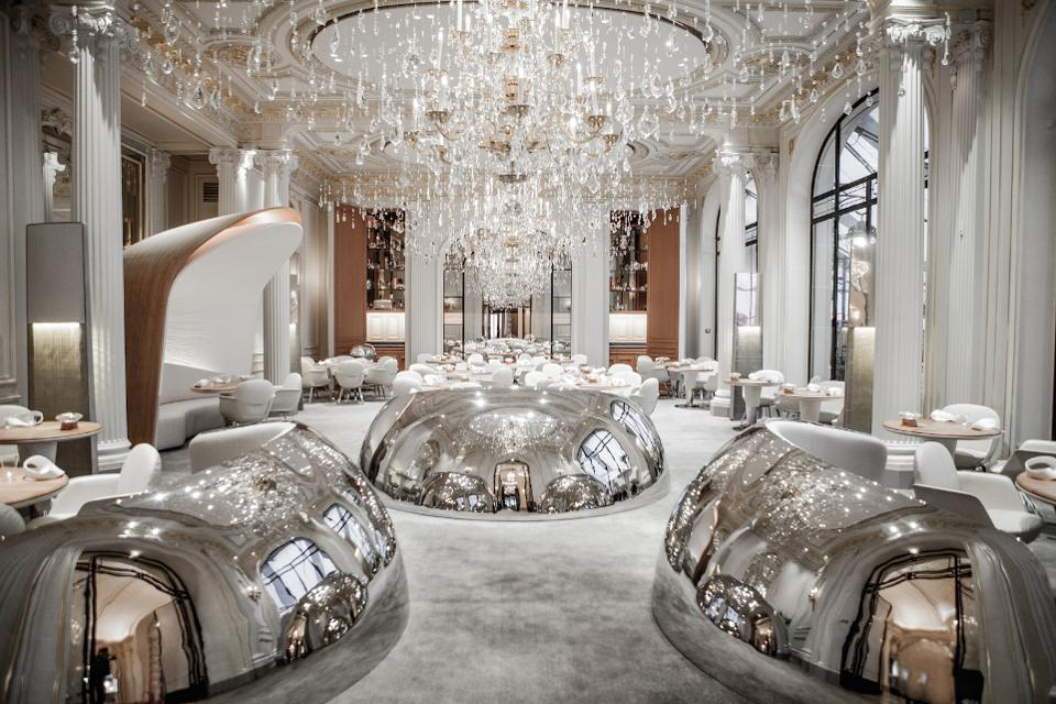 Alain Ducasse restaurant in the Plaza Athenée...there are many shiny objects to get excited about in this room but it's really all about the chandeliers!  Looks like diamond raindrops falling from the sky - an exquisite space