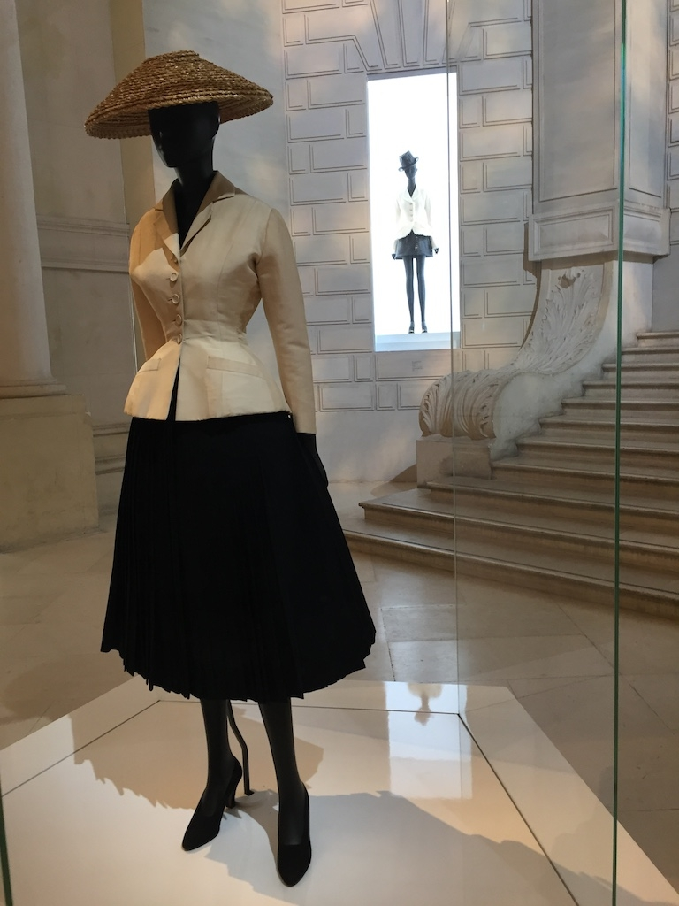 Christian Dior's bar jacket and its revolutionary silhouette takes pride of place at the entrance to the exhibition