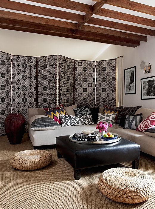 Photo by Tim Street­-Porter; home of Ellen Pompeo   A versatile folding screen decoratively closes off part of the room while adding drama, texture and pattern for a Bohemian effect