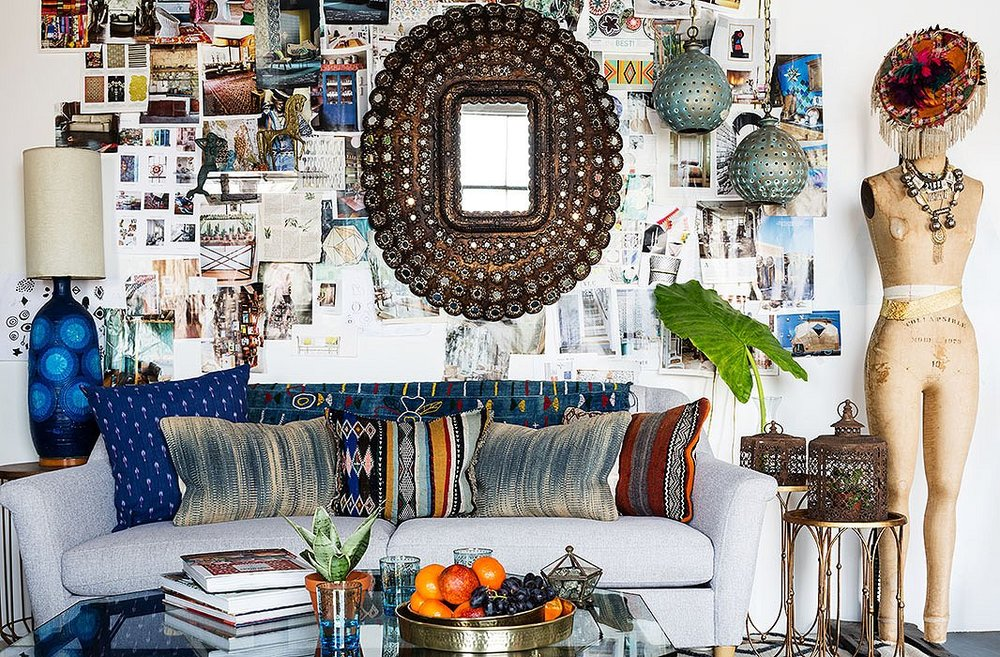 Photo by Nicole LaMotte; studio of Justina Blakeney   This eclectic look is like an art installation with the layers of photos, mirror, objets and the pillow grouping on the sofa...it's busy but feels very personal
