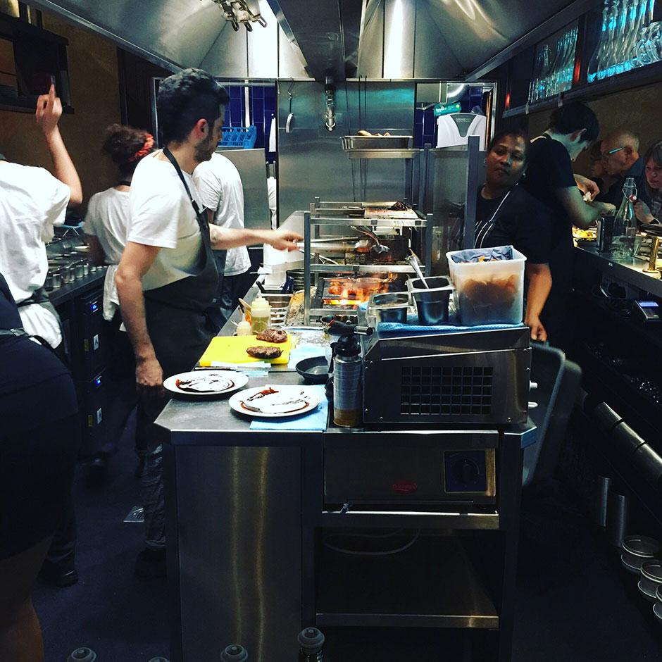chefs at work in the kitchen bar