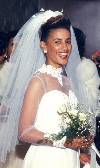 Amsale on her wedding day in 1985 is the beautiful bride in one of her namesake designs -  credit Amsale
