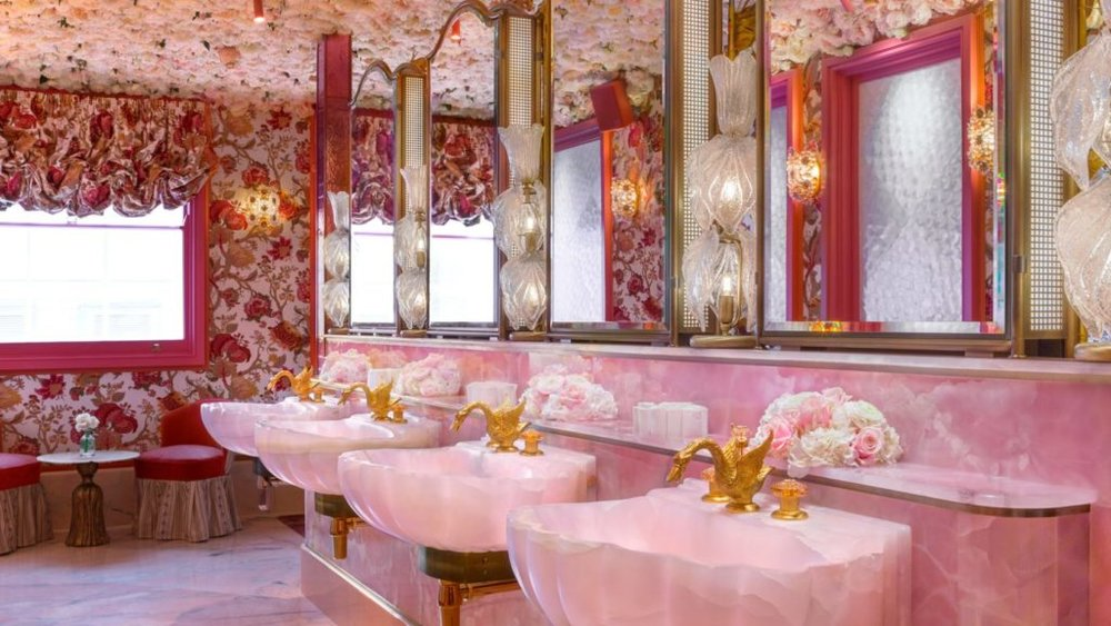 The to-die-for ladies room with luminous pink onyx sinks and gold swan faucets is already the hit of Instagram.  I mean really how could you resist?