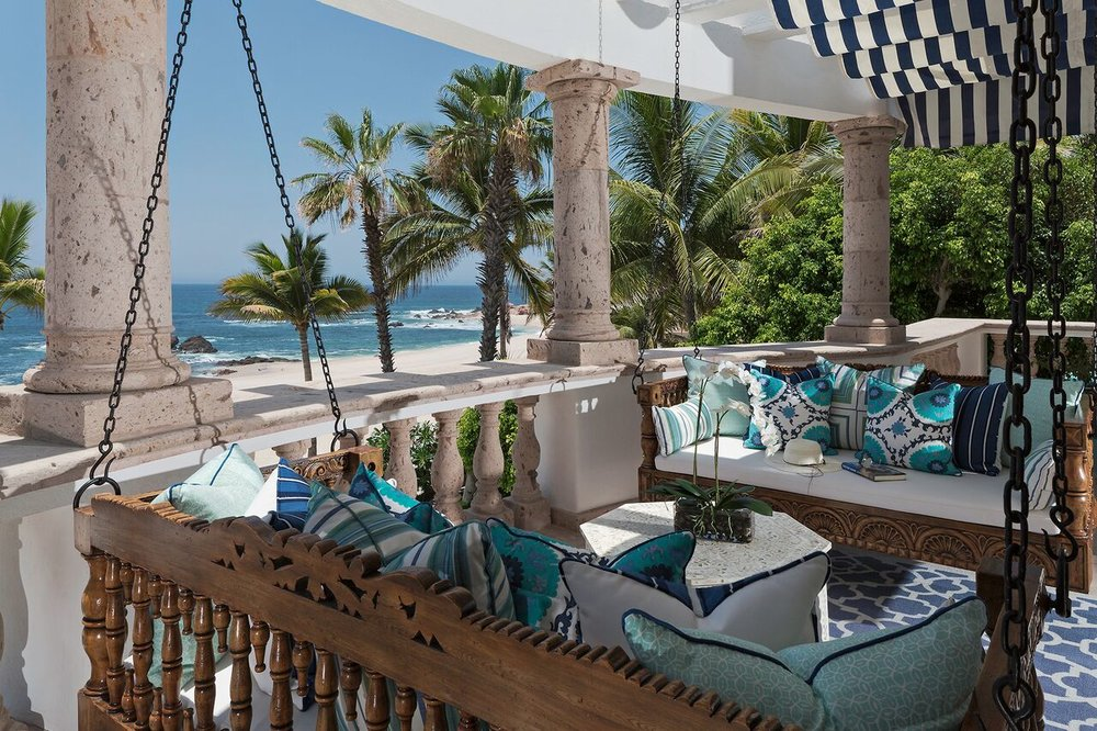 Overlooking the sea of Cortez classic hand-carved wood hanging daybeds embody the essence of barefoot luxury