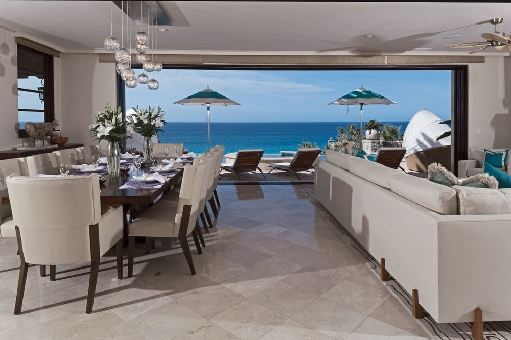 Outdoor oasis -the cool neutral palette of this informal living/dining area is the perfect backdrop for the panoramic ocean view