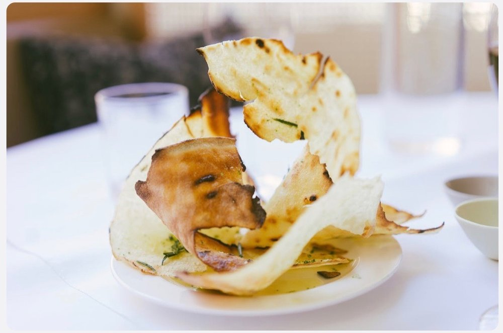 Carta di musica, a classic Sardinian flat bread drizzled with olive oil and flecked with rosemary -King's refreshing take on the breadbasket
