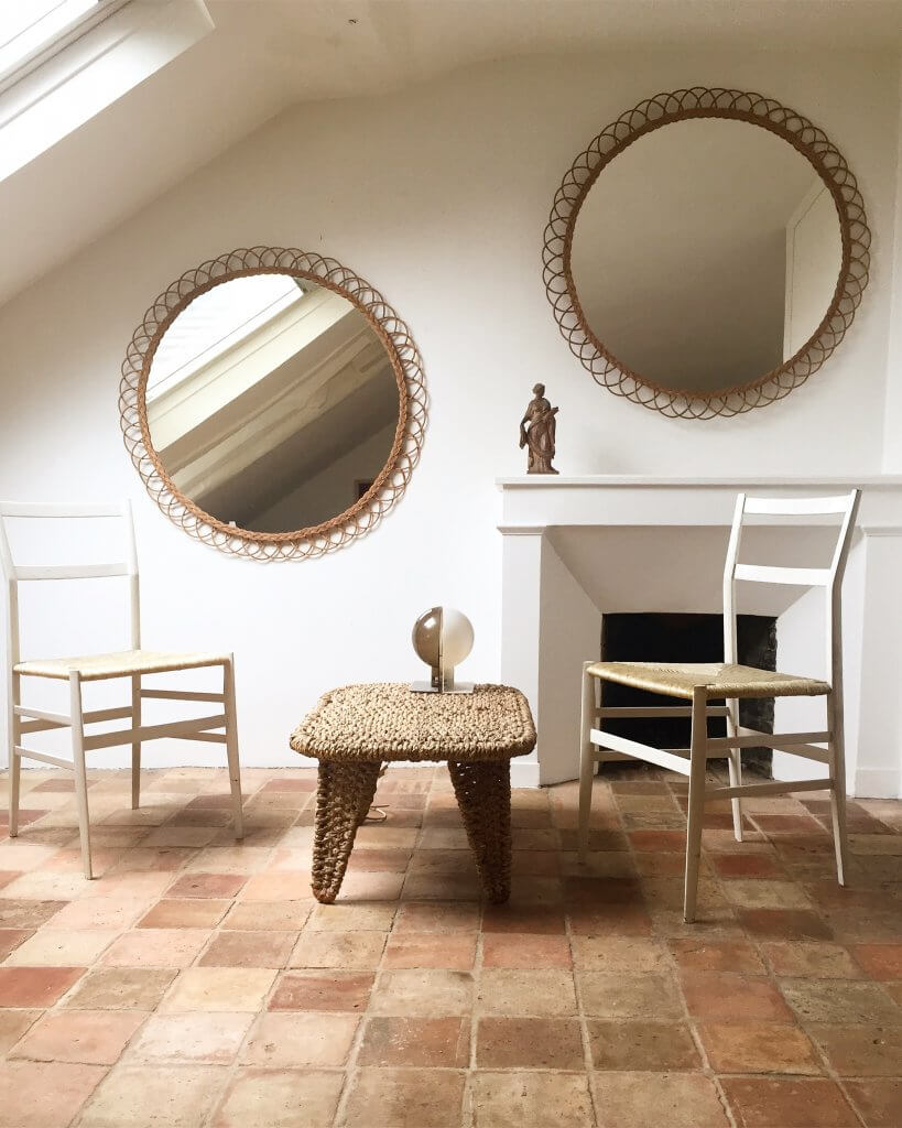 atelier-vime-round-woven-rattan-wall-mirrors-wicker-tile-floors-france-white-walls.jpg
