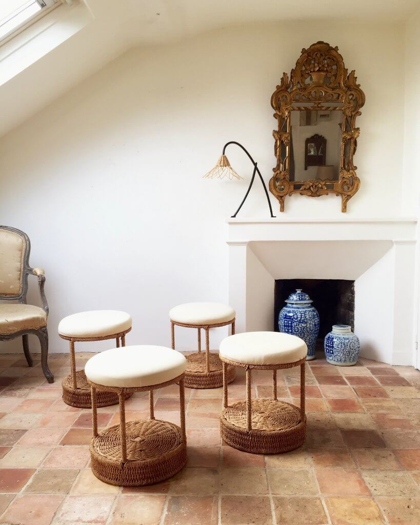 Classic blue & white jars offset the beautifully woven rattan stools