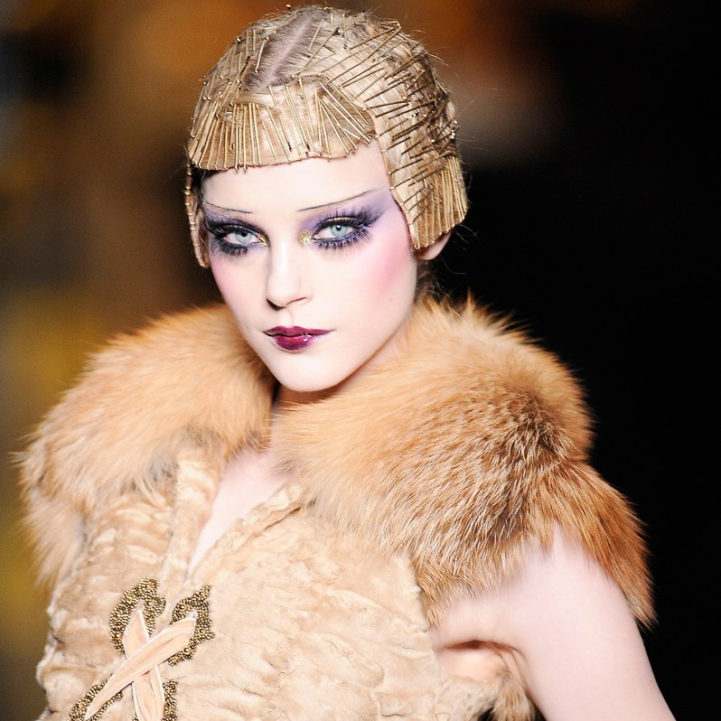 "Christian Dior Fall 2009    ""This was an exploration of 1920's Geisha glamour with an homage à Poiret with bold eyes, thin brows, and a degradé lip,"" says McGrath.  Allure Magazine; Phorography - Chris Moore"