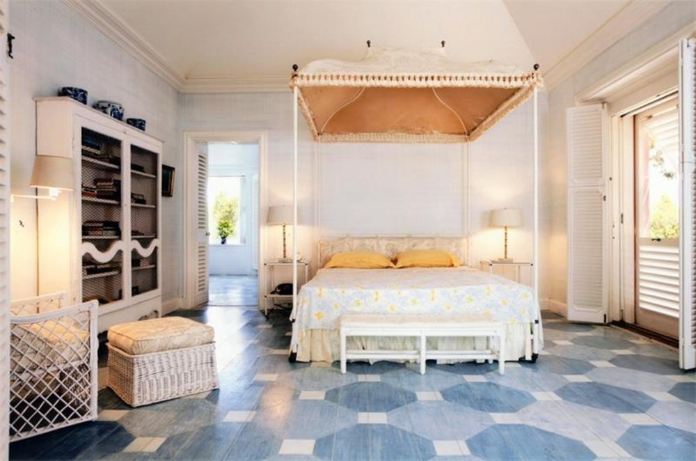 One of Bunny Mellon's guest bedrooms with island appropriate all-white cane and wicker furnishings - loving the custom painted floors