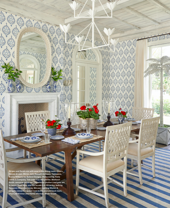 The oak dining table nicely grounds the room's blue and white color scheme