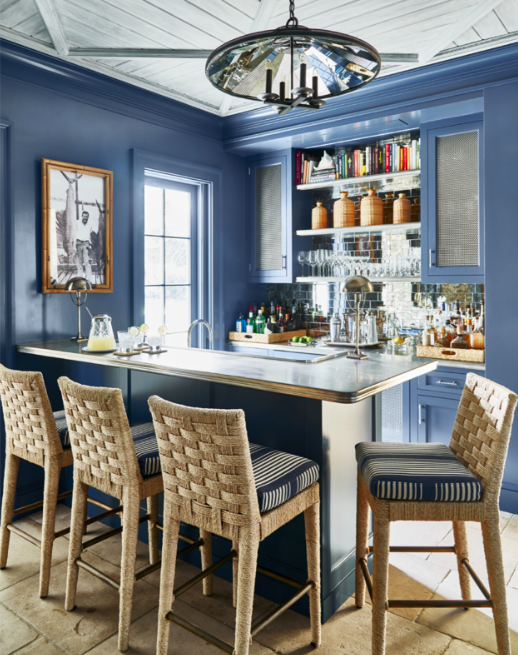 Benjamin Moore's Van Deusen Blue paint wraps the walls, moldings and cabinetry for a glam glossy finish