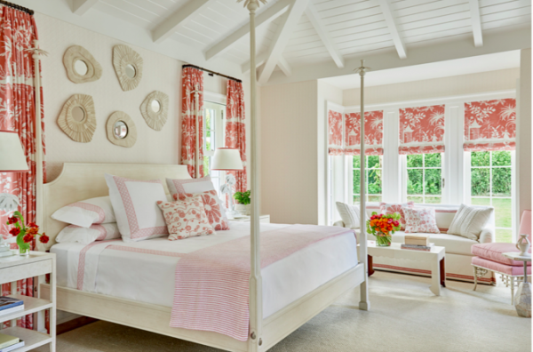 The master bedroom is a soothing oasis of whites, corals and a classic China Seas toile for the drapes and shades adds a pattern of interest