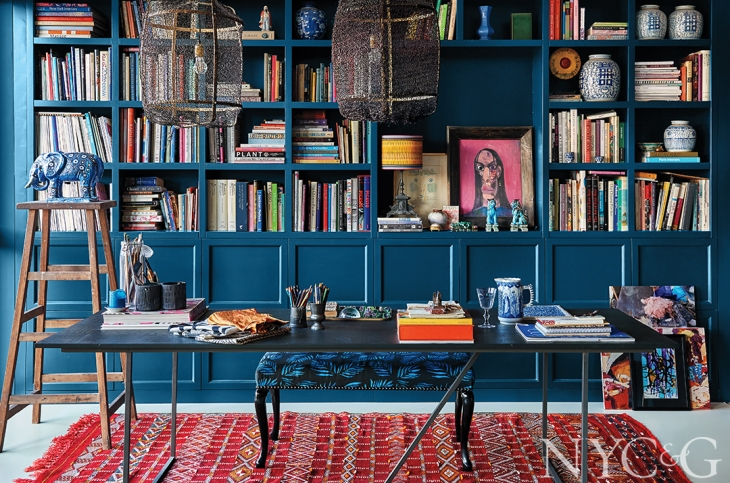 Blue and red is probably my favorite color combination for interiors, especially when my intention is to bring warmth and intimacy to the space…I have a red and blue media room which no-one ever wants to leave due to its high cozy factor...in Mariska's workspace the bookcase continues the Farrow & Ball Hague Blue theme, giving the shelves high visual impact - you can remove a book without ruining the entire look…just love the porcelain elephant sitting on the ladder - I'm assuming no small children live here