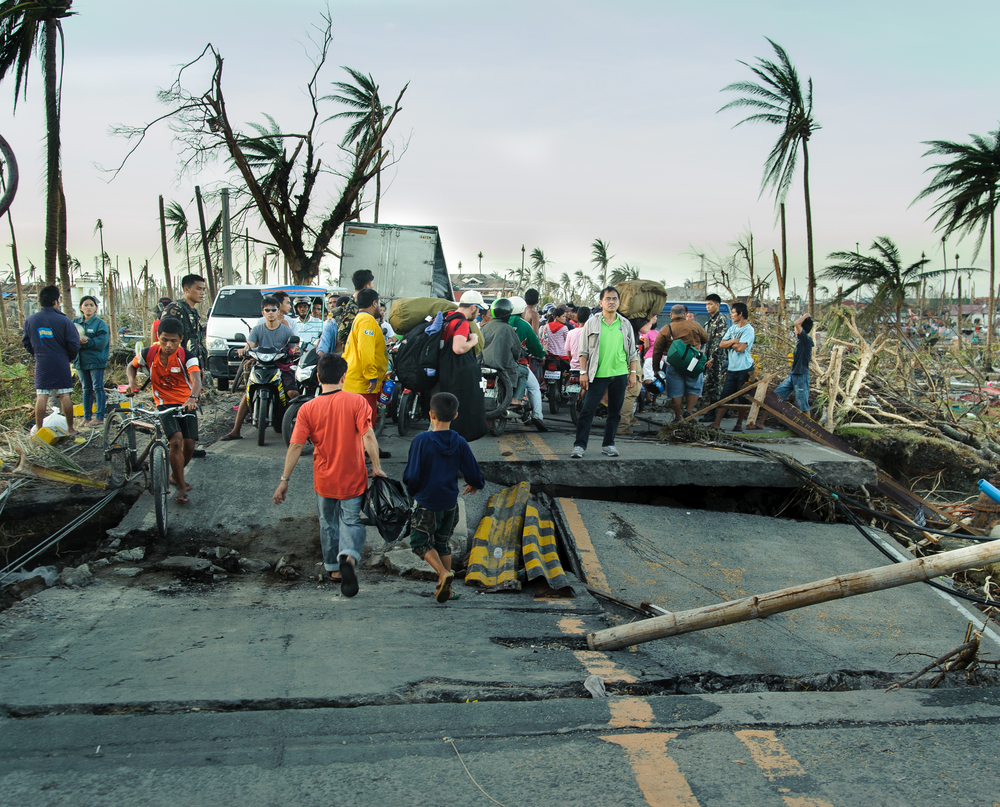 Team members and local residents must navigate their way over fallen electrical lines and roads destroyed by the storm as they approach the town from the south.