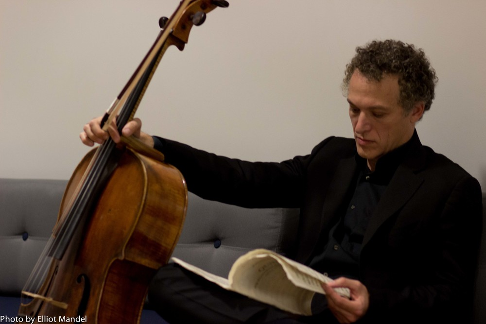 Cellist Brandon Vamos studies Brahms during intermission.