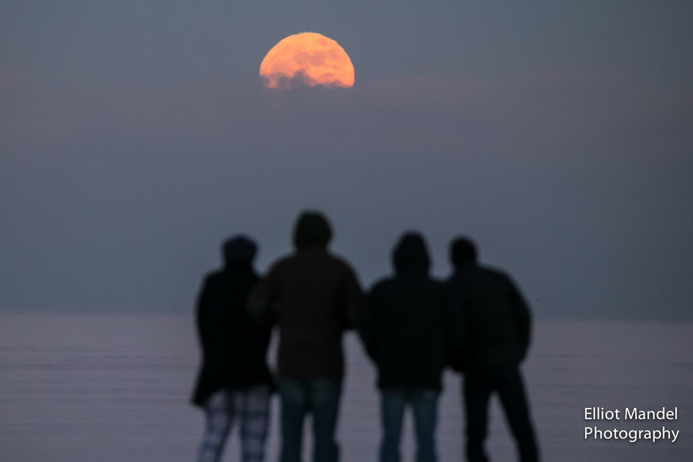 A Supermoon rises over Lake Michigan on January 1, 2018.