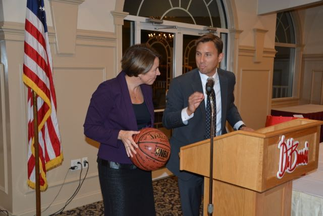 Attorney General Healey is presented with a basketball signed by members of the Lawrence Boys and Girls Club