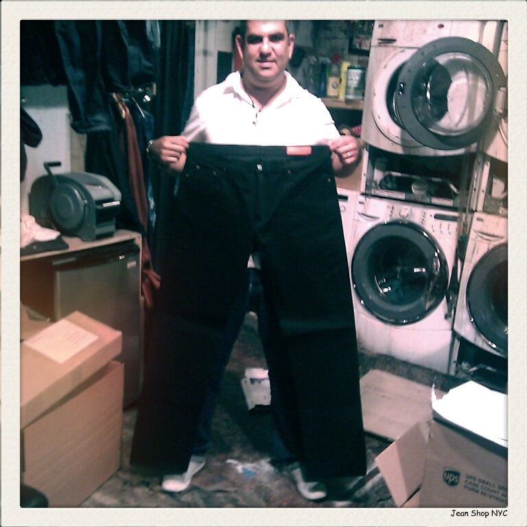 """Eric(@EricKGoldstein) holding up a pair of our Rockers with a 40"""" inseam that he custom cut for a client."""