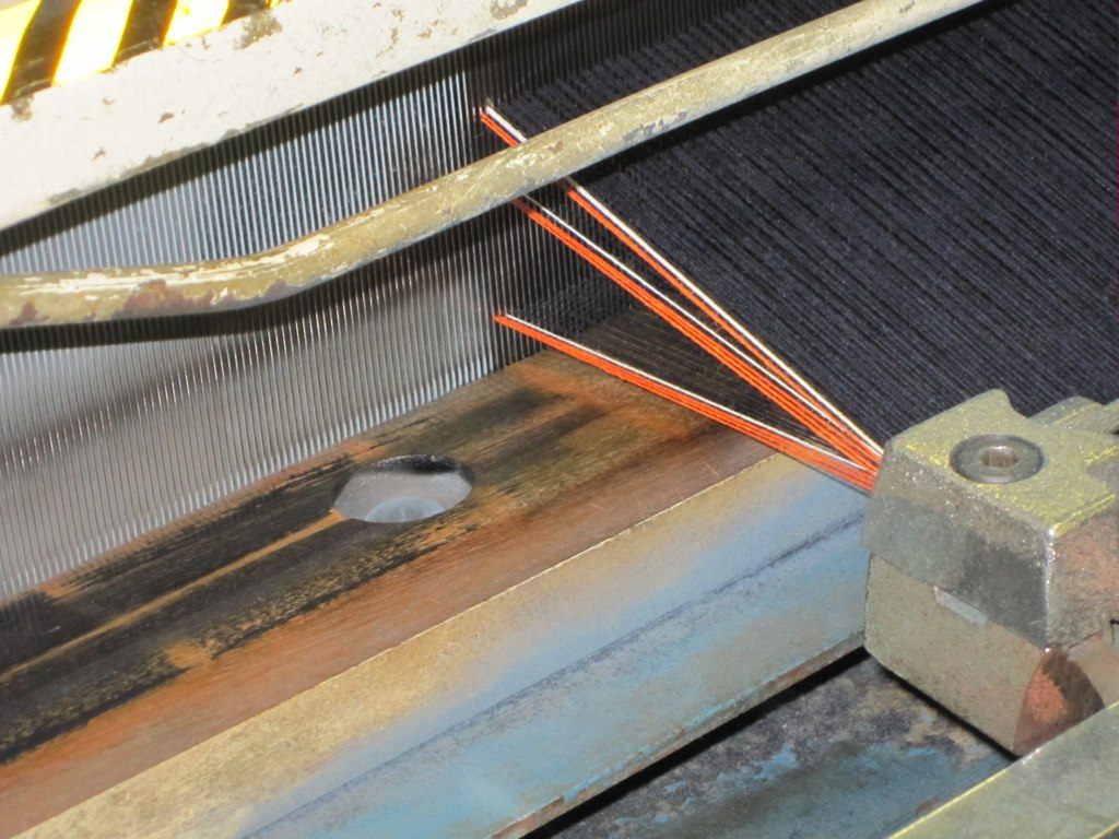 This is an up close picture of our loom in Japan weaving our Jean Shop trademark orange and white selvedge denim. This is the old school way of doing it. It takes about 1.5 hours to weave enough fabric for one pair of jeans. Stop in to Jean Shop at 434 W 14th or go to www.worldjeanshop.com to see more.