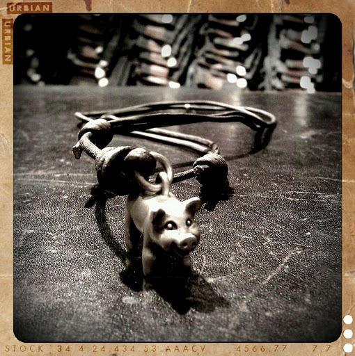 One of the many Poor Cat charms we carry in our shops. Of course I had to feature the Pig charm.
