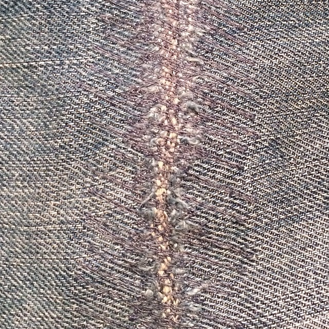 Repair done with our darning machine that was made in 1940. This jean had a three inch hole before we started. Beautiful job. Bring your jeans in for a quick repair. #darning #repair #madeinamerica #madeinusa #denim #jeans #jeanshop #selvedge #japaneseselvedge #fashion #style #cotton
