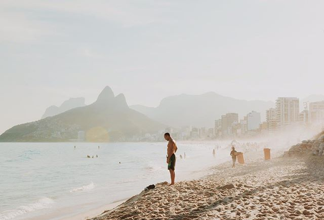 ✨ On Ipanema beach right before the sun begins to set, a palpable hazy glow drenches everything in sight. Waves of beachgoers are reduced to faint outlines flickering in the light. Simultaneously, the monolith cliffs, once looming in the background, transform into giant silhouettes overshadowed by a pastel sky. A scene of pure magic. ✨ . . . . . #riodejaneiro #ipanemabeach #praiadeipanema #ipanema #sunset #travelbrazil #brazil #passionpassport #natgeotravel #southamerica #obrigado #darlingescapes #girlswhotravel #travelgram #lovetotravel #traveldiary #simplyadventure #openmyworld #mytinyatlas #beautifuldestinations #brasil #summervibes #visualsoflife #highwaybrazil