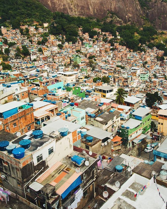 A city so stunningly beautiful is also mired in a profound state of brokenness. There are an estimated 1,000 favelas in Rio, some in states of utter anarchy and others operating peacefully under state rule. Governmental neglect and the aftermath of the largest slave trade in the Western Hemisphere necessitated the construction of informal housing for over a million people. Many communities have been overwhelmed by violence, drug gangs, inadequate resources and public facilities. (1/3) . . . . . #riodejaneiro #rocinha #favela #rocinhafavela  #travelbrazil #brazil #passionpassport #natgeotravel #southamerica #obrigado #darlingescapes #girlswhotravel #travelgram #lovetotravel #traveldiary #simplyadventure #openmyworld #mytinyatlas #beautifuldestinations #brasil #summervibes #visualsoflife #highwaybrazil