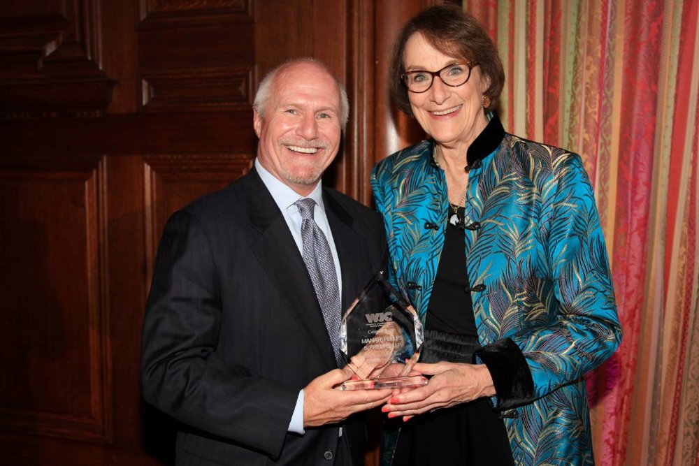 Manatt, Phelps & Phillips, LLP partner and WJC Board Member Craig de Recat, Esq. accepts the Defender of Justice Award from WJC Executive Director Judge Judith C. Chirlin (Ret.) on behalf of his firm.