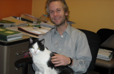 Cody pictured at ALS (with office rescue cat Obie)