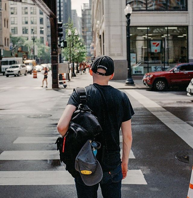 Black on black never looked so good! Nemi wearing our Rollpack in Chicago #roamwithus