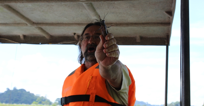 Captain Carl shows off one big grasshopper.