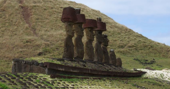 The ahu with seven moai at Anakena. Note that four have their pukao in place.
