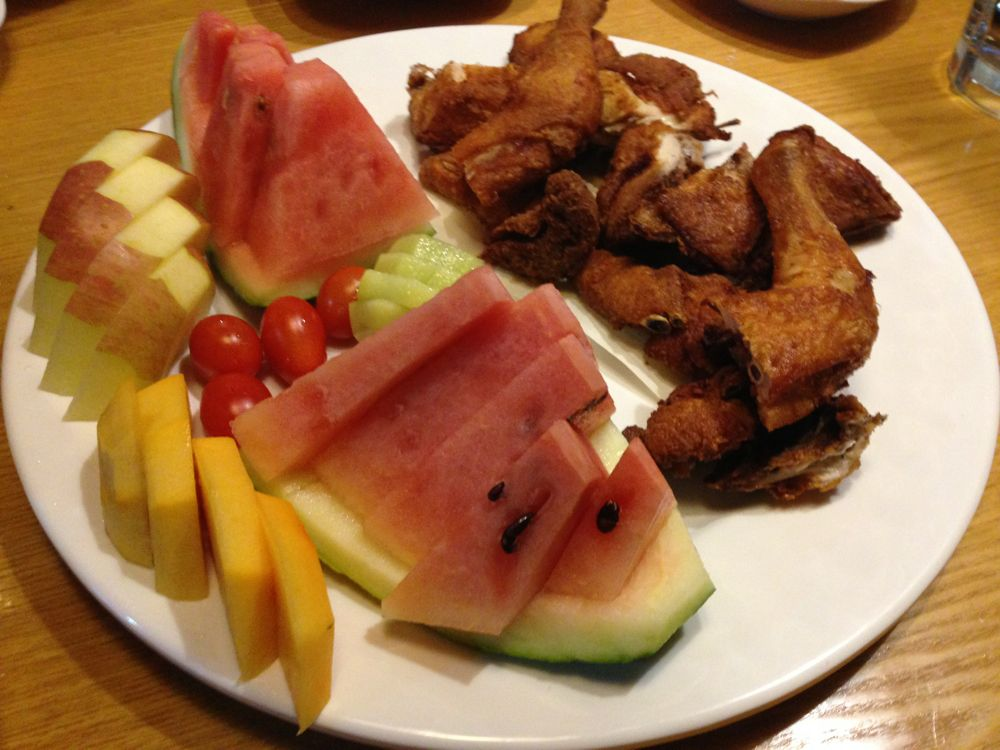 Fried chicken and fruit plate
