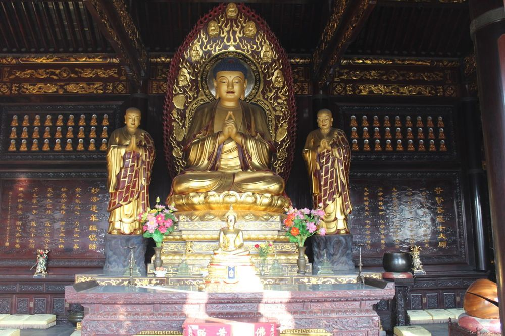 Buddha and his two closest disciples.