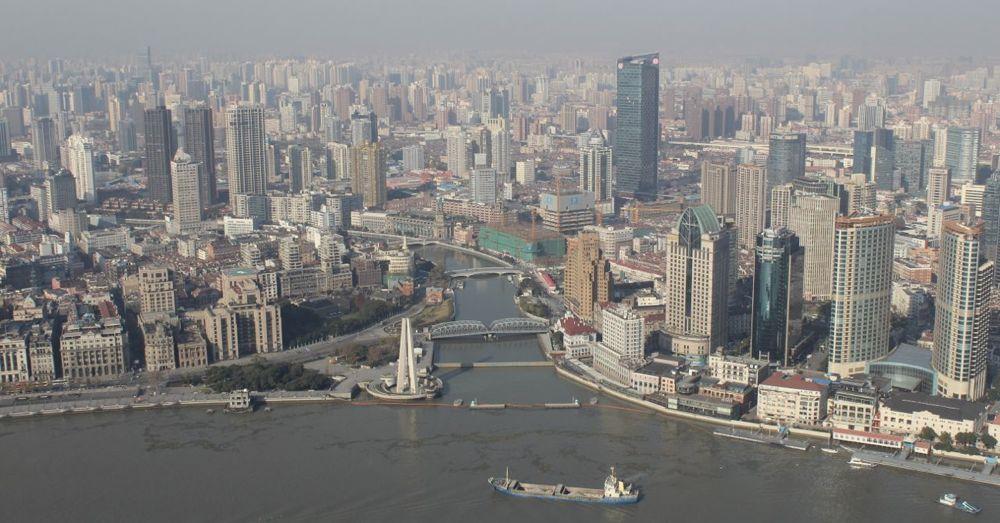 Looking across the Huangpu River .