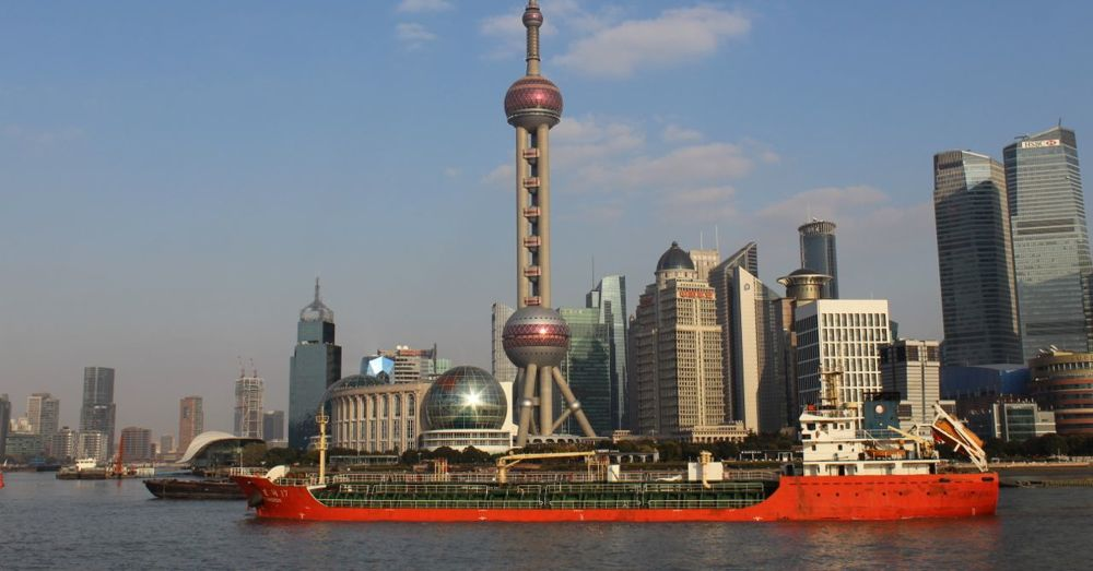The Bund: across the Huangpu River. That ship is the  Dong Run 17 , an oil & chemical tanker. Follow her progress at  VesselFinder .