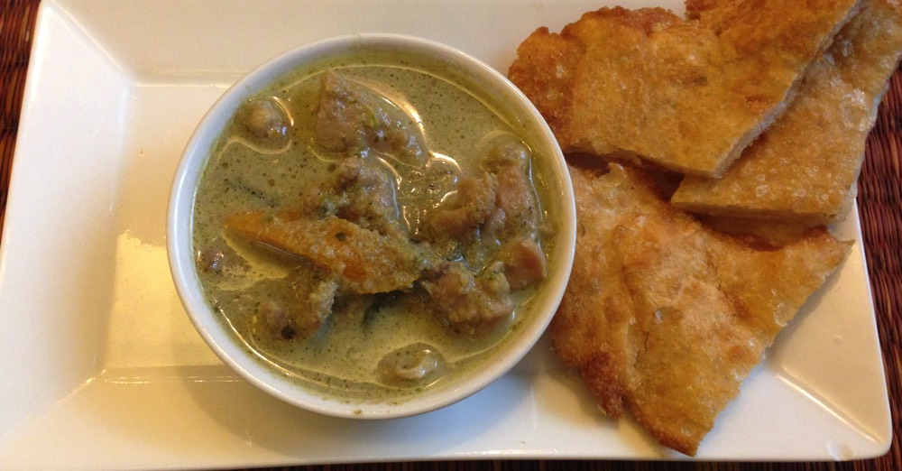 Green curry served with roti.