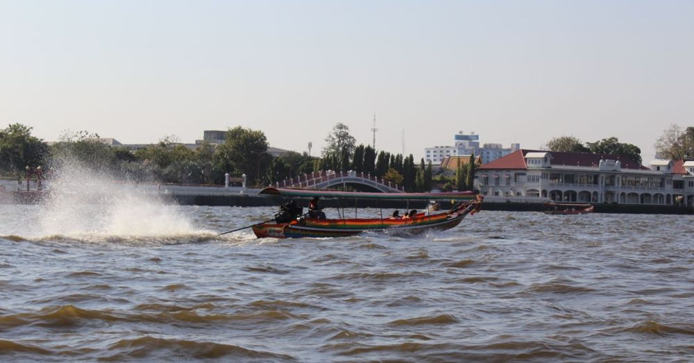 Long-tail boat speeding on Chao Phraya.