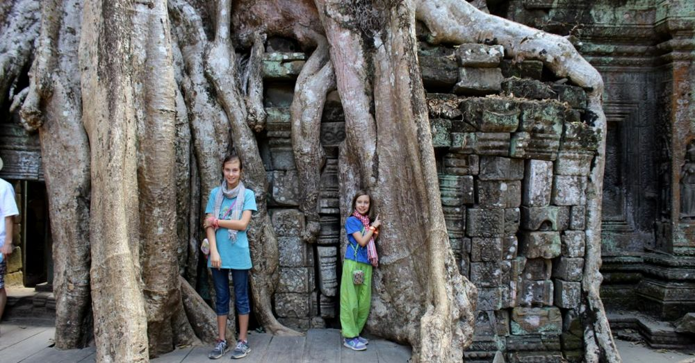Girls among the roots in Ta Prohm