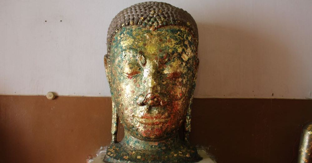 Buddha Head in Gold Leaf and Coins