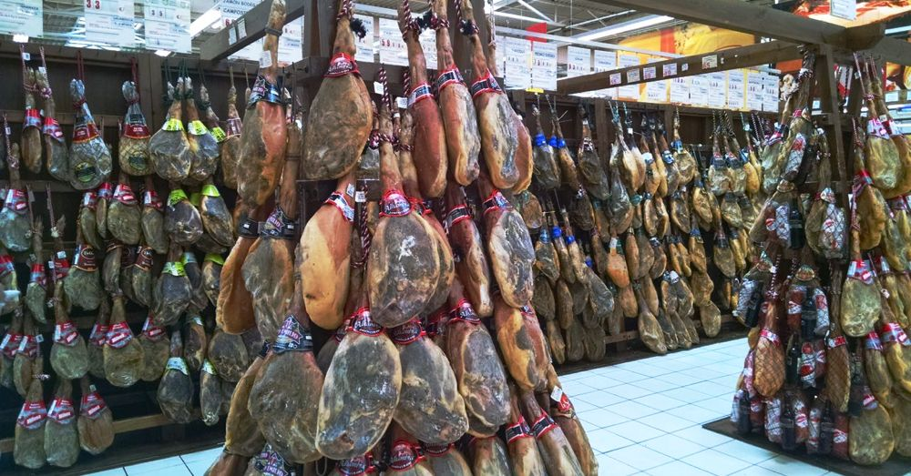 Aisle of jamón. No, we didn't buy one of these.