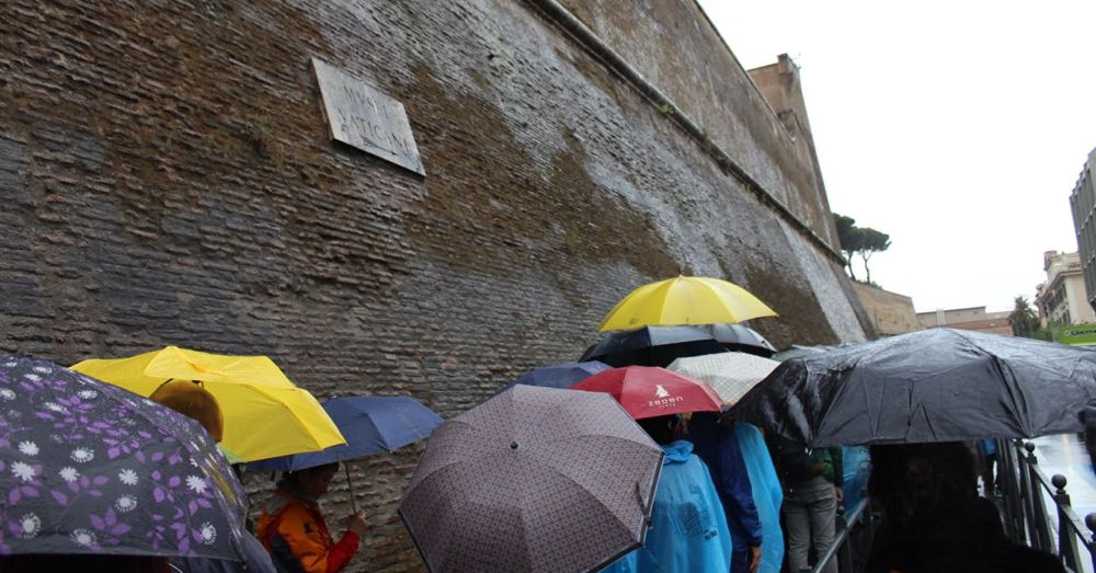 Waiting for Vatican Museum tickets in the rain.