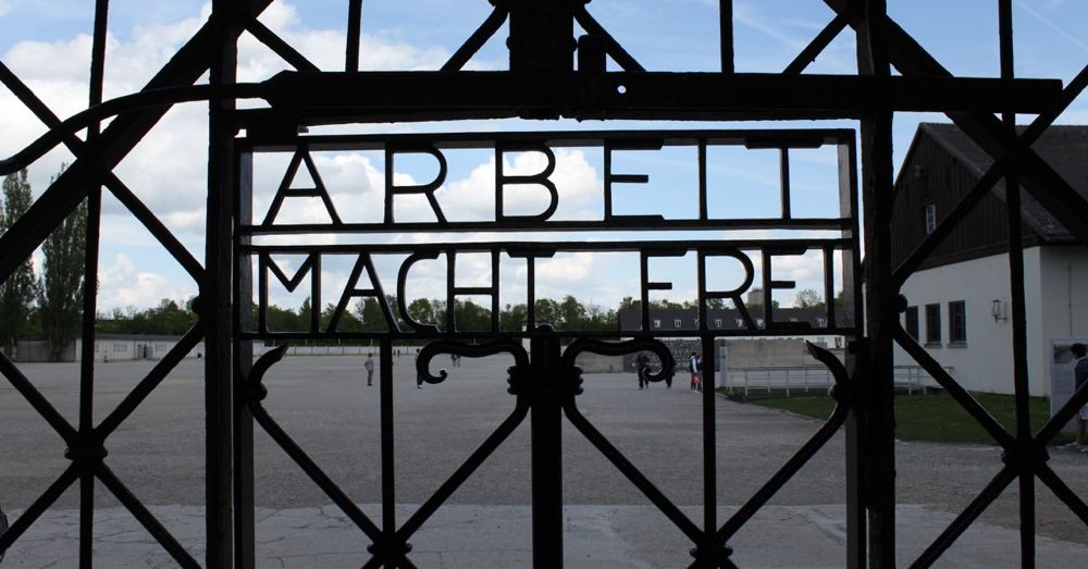 "The notorious gate into Dachau (a replica). Translated, it says ""Work sets you free."""