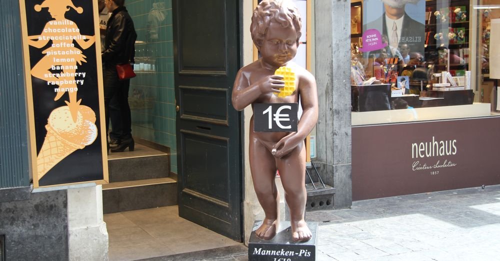 He's everywhere: Manneken Pis in front of one of the many one euro waffle shops in Brussels.