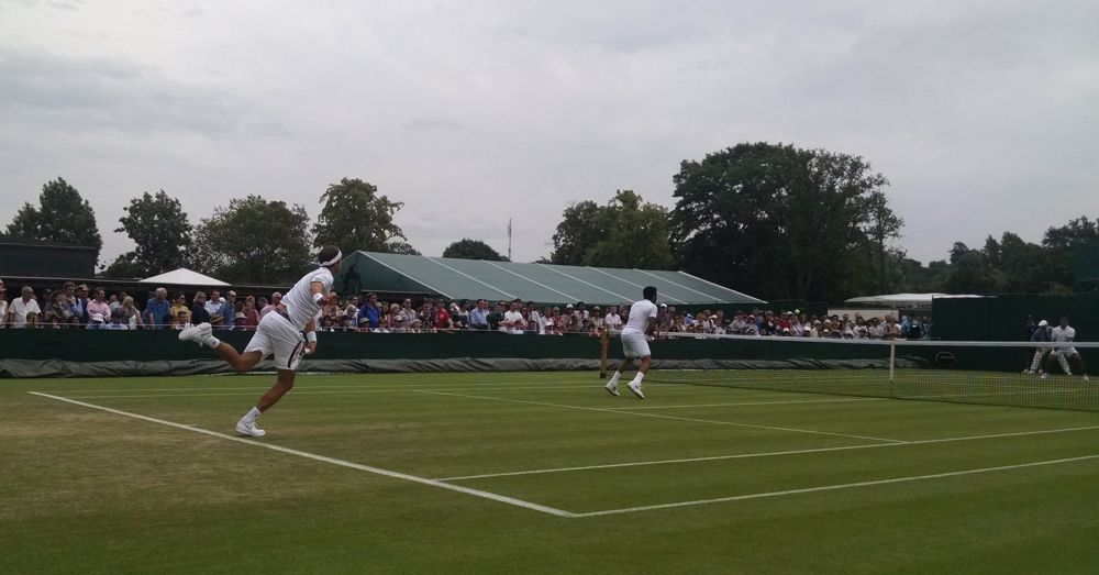 Müller (left) and Qureshi in a Wimbledon doubles match.