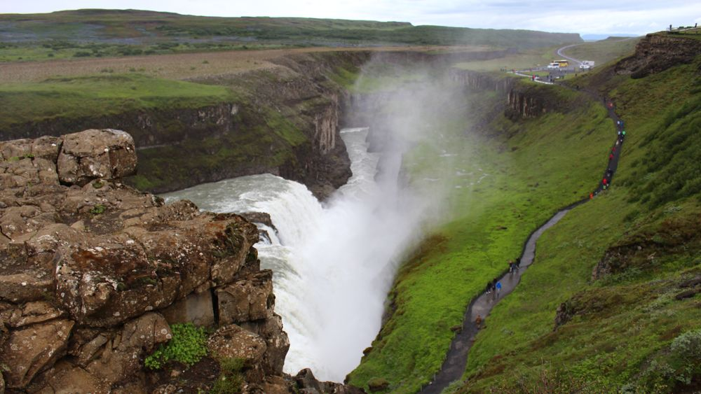 Gullfoss plunges down 31 meters. Note the people on the path for scale.