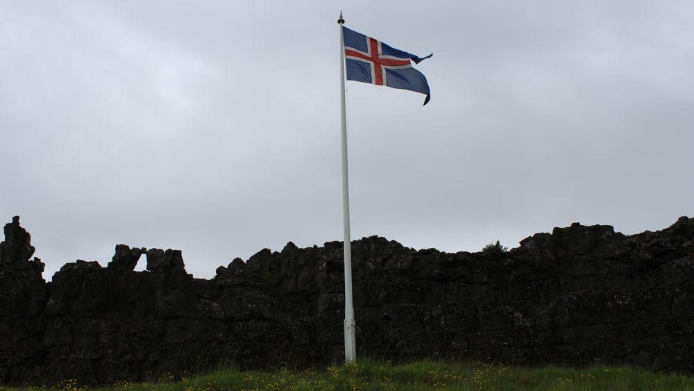 The Icelandic flag flying at Löberg (Law Rock) in Þingvellir.