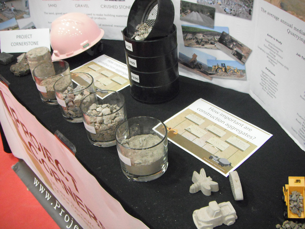 Construction aggregate samples and industry facts displayed in the Project Cornerstone Career Day booth.
