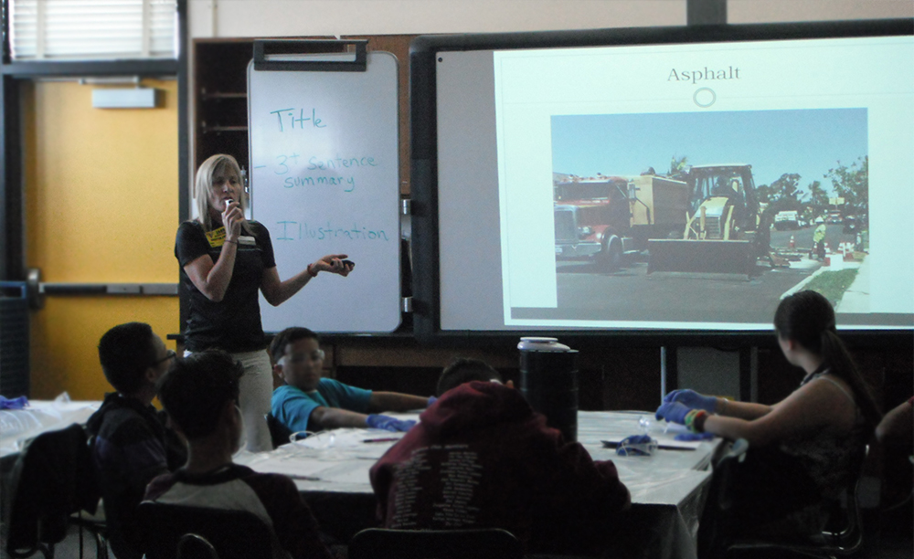 Crystal Howard presents information about local construction aggregates to eight grade students at Jean Farb Middle School. Photo by Alyssa Burley.